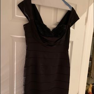 Gorgeous black mid-length fitted dress. Size 10.